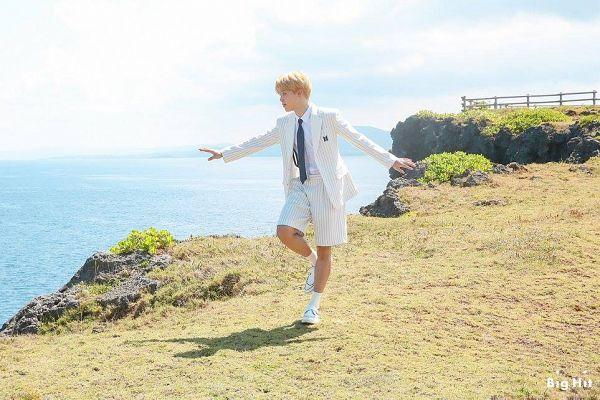 Tags: K-Pop, BTS, Park Jimin, Tie, White Shorts, White Outfit, Striped Jacket, Blunt Bangs, White Footwear, White Jacket, Socks, Standing On One Leg