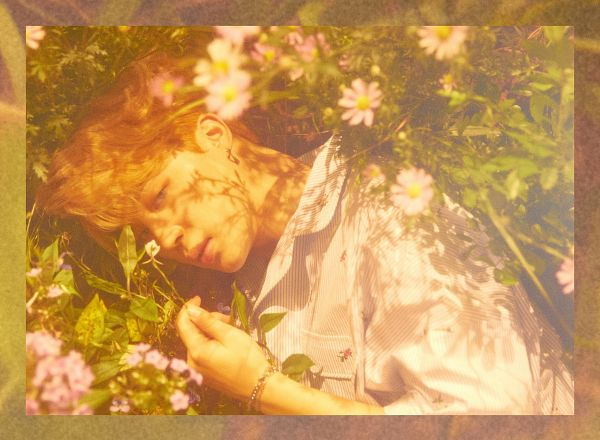 Tags: K-Pop, Bangtan Boys, Park Jimin, Leaf, Flower, Close Up, Collar (Clothes), Blonde Hair, Laying On Ground, Pink Flower, Laying Down, Frame
