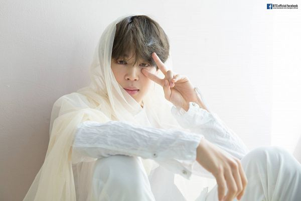 Tags: K-Pop, Bangtan Boys, Park Jimin, White Outfit, Text: URL, English Text, Sitting On Ground, White Pants, Light Background, Text: Artist Name, Wall, V Gesture