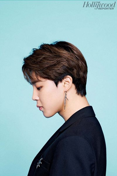 Tags: K-Pop, BTS, Park Jimin, Black Outerwear, Blue Background, Text: Magazine Name, Black Jacket, Looking Down, Side View, Magazine Scan, The Hollywood Reporter