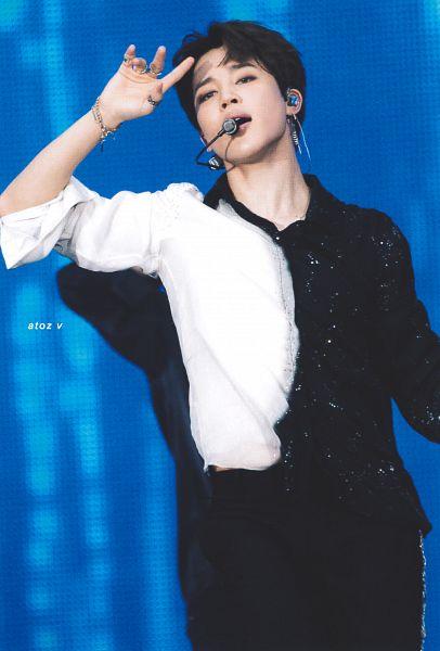 Tags: K-Pop, BTS, Serendipity, Park Jimin, Necklace, Blue Background, Singing, One Arm Up, Black Pants, Dancing, Black Eyes, Ring