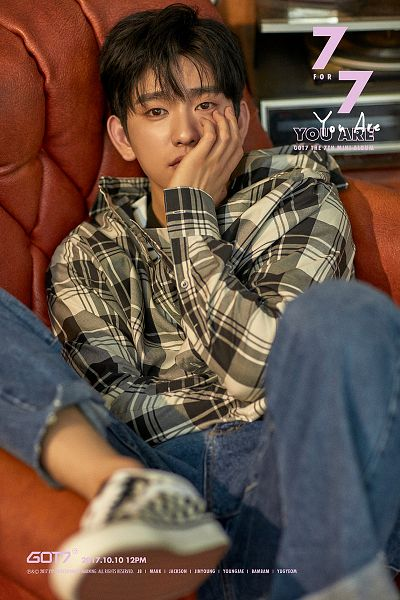 Tags: K-Pop, Got7, Park Jinyoung (Junior), Text: Album Name, Armchair, Text: Song Title, Checkered Shirt, Blue Pants, Checkered, Sitting On Chair, Serious, Text: Calendar Date