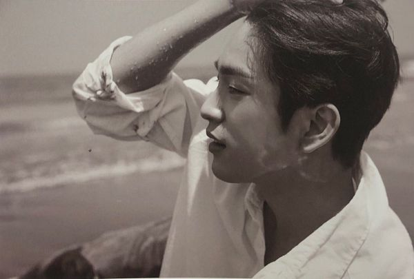Tags: K-Pop, Got7, Park Jinyoung (Junior), Sand, Side View, Outdoors, Laying Down, Serious, Sea, Water, Beach, Looking Ahead