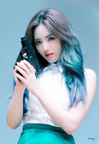 Tags: K-Pop, fromis 9, Park Jiwon, Green Skirt, Bare Shoulders, Make Up, Holding Object, Nail Polish, Blue Background, Weapons, Blue Hair, Gun