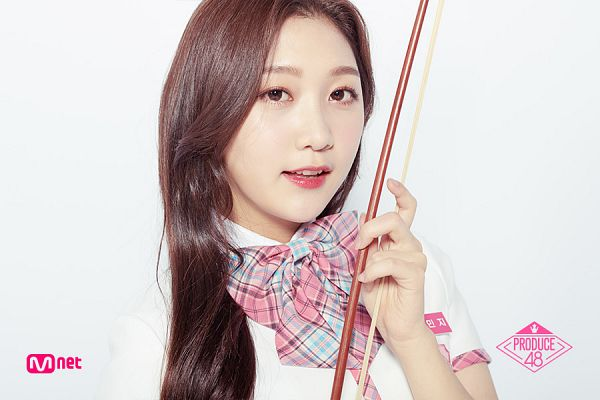 Tags: Television Show, K-Pop, Park Minji, Text: Series Name, Holding Object, Close Up, White Footwear, Bow Tie, Short Sleeves, Checkered Neckwear, Produce 48