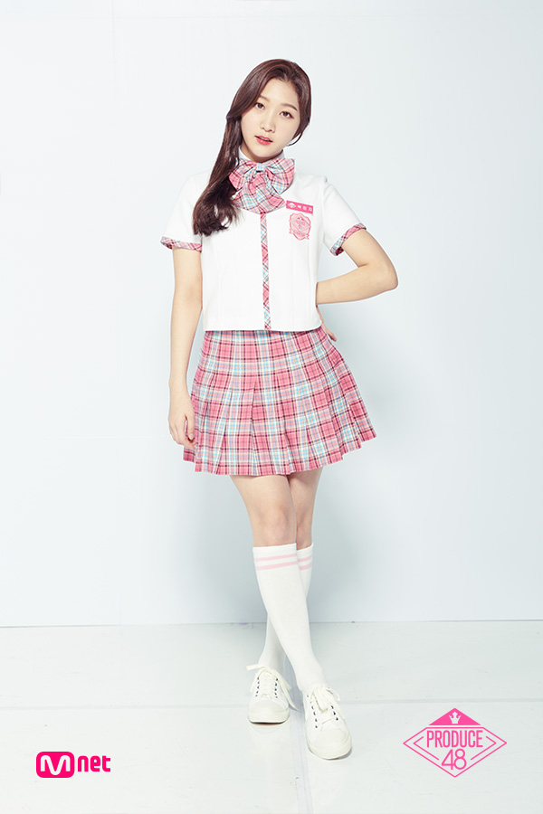 Tags: K-Pop, Television Show, Park Minji, Short Sleeves, Checkered Neckwear, Bow Tie, Checkered Skirt, Text: Series Name, Thigh Highs, White Footwear, Sneakers, Checkered