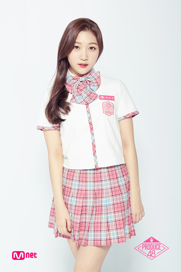 Tags: K-Pop, Television Show, Park Minji, Skirt, Text: Artist Name, Short Sleeves, Checkered Neckwear, Checkered Skirt, Text: Series Name, White Footwear, Close Up, Checkered