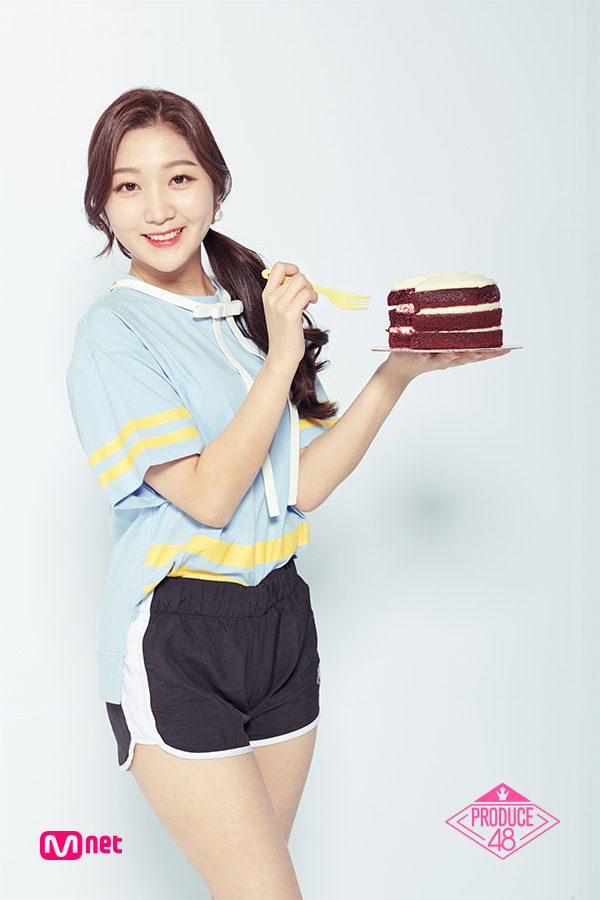 Tags: Television Show, K-Pop, Park Minji, Text: Series Name, Cake, Hair Up, White Neckwear, Short Sleeves, Sweets, Ponytail, Blue Shirt, Shorts