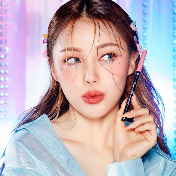 Tags: K-Pop, Pony, Nail Polish, Looking Away, Make Up, Collarbone, Blue Shirt, Hair Ornament, Multi-colored Background, Blue Eyes