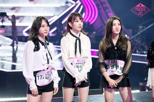 Tags: J-Pop, K-Pop, Television Show, IZ*ONE, HKT48, Rocket Punch, Kwon Eunbi, Takahashi Juri, Miyawaki Sakura, Black Dress, Bare Legs, Text: Series Name