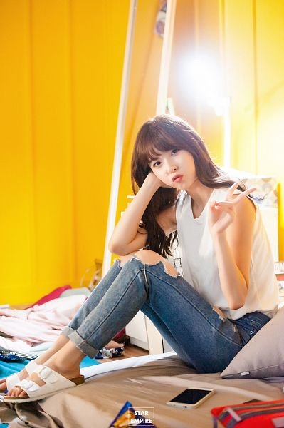 Tags: K-Pop, Nine Muses, Pyo Hyemi, Bare Shoulders, Sleeveless Shirt, V Gesture, Phone, Yellow Background, Pouting, Jeans, White Footwear, Hand In Hair