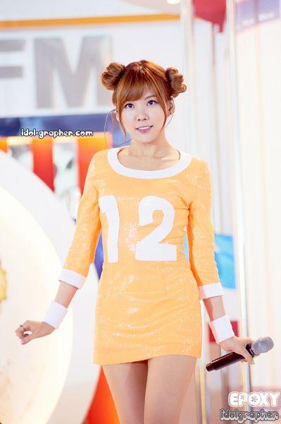 Tags: K-Pop, Orange Caramel, After School, Raina, Orange Outfit, Hair Buns, Hair Up, Twin Buns, Orange Dress, Blunt Bangs, Live Performance