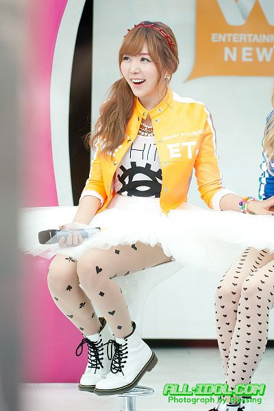 Tags: K-Pop, After School, Orange Caramel, Raina, Hair Up, Blunt Bangs, White Skirt, Ponytail, Necklace, Orange Outerwear, Skirt