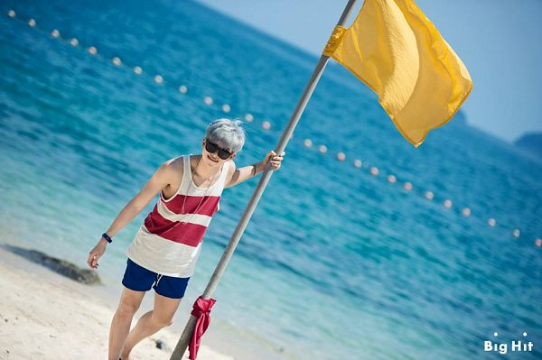 Tags: K-Pop, BTS, Rap Monster, Necklace, Watch, Dutch Angle, Sunglasses, Sand, Striped Shirt, Flag, Shorts, Wristwatch