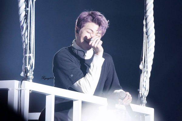 Tags: K-Pop, BTS, Rap Monster, Heart Gesture, Stage, Choker, Purple Hair, Ring, Hot Air Balloon, Bag, Eyes Closed, Earbuds