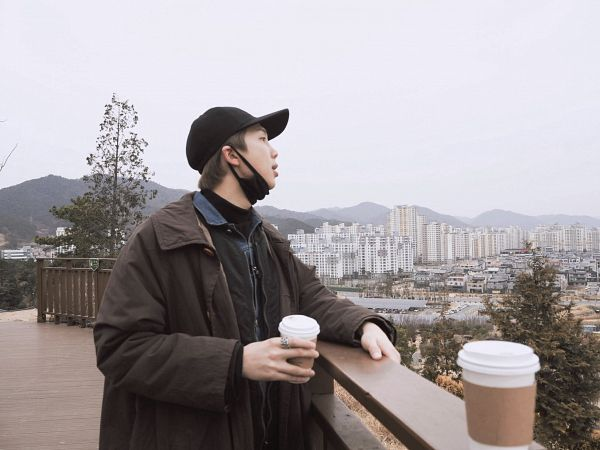 Tags: K-Pop, BTS, Rap Monster, Sky, Outdoors, Side View, Coffee, Tree, Mask Off, Coat, Plant, Face Mask