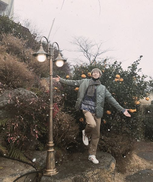 Tags: K-Pop, BTS, Rap Monster, Brown Pants, Snow, Mask, Mask Off, Plant, Sky, Leg Up, Sneakers, Standing On One Leg