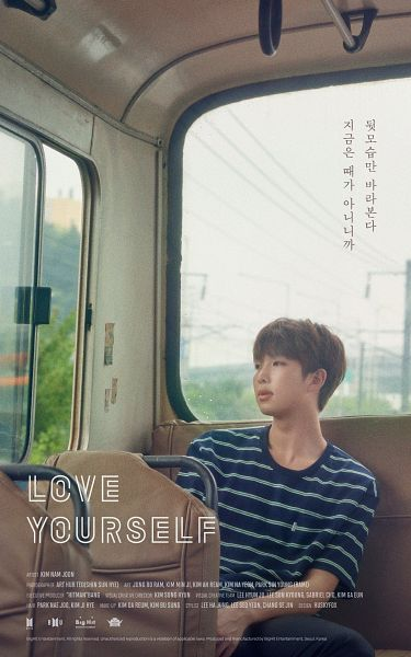 Tags: K-Pop, BTS, Rap Monster, Black Pants, Plant, Short Sleeves, Text: Company Name, English Text, Striped, Bus, Looking Away, Korean Text