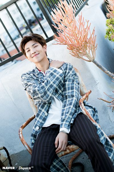 Tags: K-Pop, BTS, Rap Monster, Striped, Striped Pants, Necklace, Black Pants, Plaided Print, Chair, Hand On Shoulder, Open Coat, Sitting On Chair