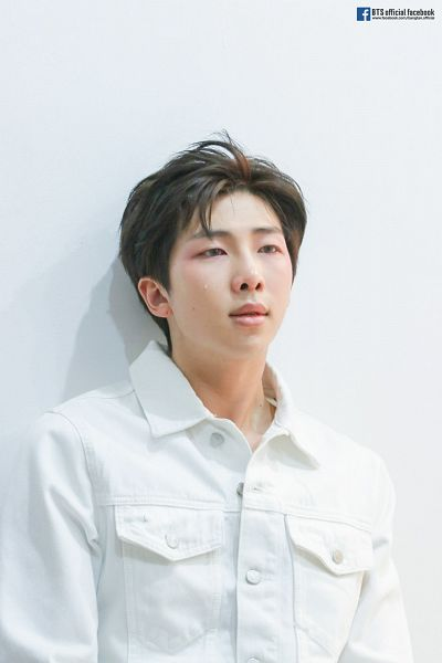 Tags: K-Pop, Bangtan Boys, Rap Monster, Shadow, Gray Background, Text: URL, Light Background, Looking Ahead, White Outerwear, Crying, Denim Jacket, White Jacket
