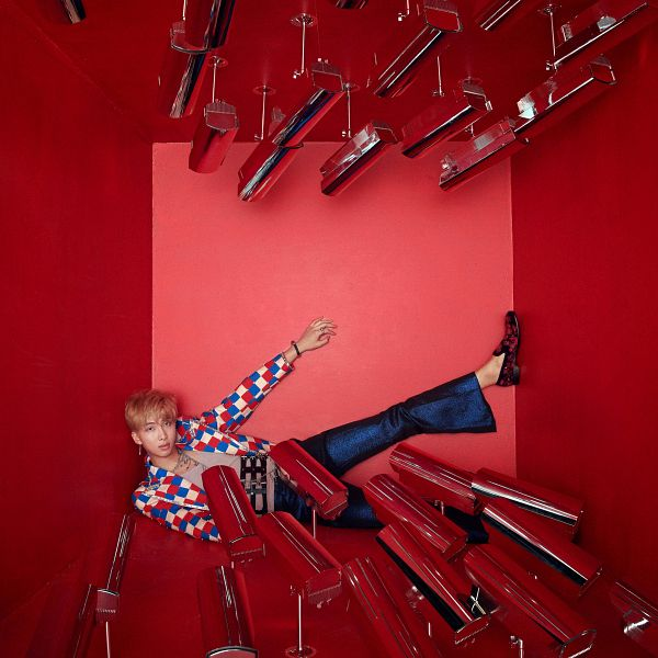Tags: K-Pop, BTS, Rap Monster, Necklace, Ring, Checkered, Jeans, Laying Down, Bracelet, Camera, Checkered Jacket, Red Background