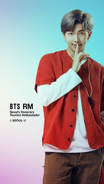 Tags: K-Pop, BTS, Rap Monster, Light Background, Text: Artist Name, Hand In Pocket, Brown Pants, Whistle, Finger To Lips, Gradient Background, English Text, Open Shirt