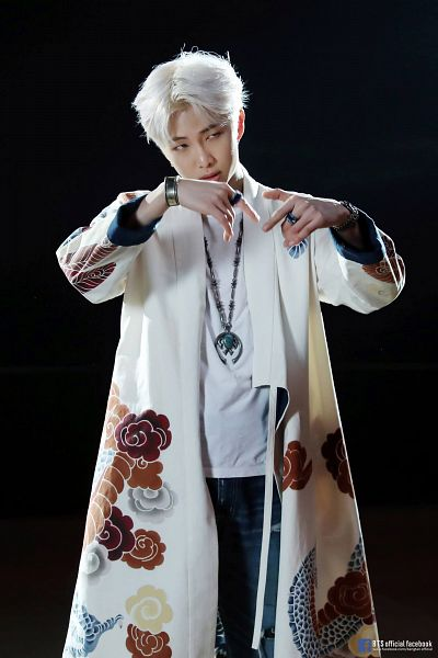 Tags: K-Pop, BTS, Persona (Song), Rap Monster, Dark Background, White Hair, Black Background, Ring, Text: URL, Robe, Necklace, Text: Artist Name