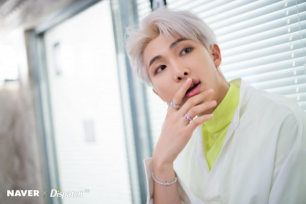 Tags: K-Pop, BTS, Boy With Luv, Rap Monster, English Text, White Jacket, White Hair, White Outerwear, Yellow Shirt, Ring, Covering Mouth, Bracelet