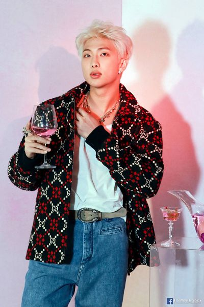 Tags: K-Pop, BTS, Rap Monster, Text: Artist Name, Glass (Cup), Cup, Drinks, Wine Glass, English Text, Alcohol, Blue Pants, Necklace