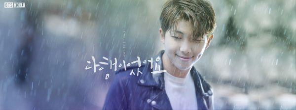 Tags: K-Pop, BTS, Rap Monster, Looking Down, Water, Dimples, Blue Jacket, English Text, Blue Outerwear, Korean Text, Rain, BTS World