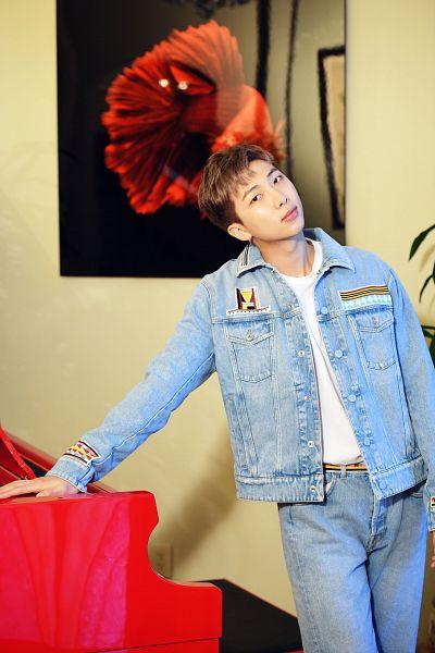 Tags: K-Pop, BTS, Rap Monster, Blue Jacket, Canvas, Head Tilt, Jeans, Denim Jacket, Blue Pants, Indoors, Musical Instrument, Piano