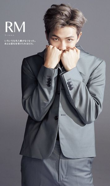 Tags: K-Pop, BTS, Rap Monster, Gray Outerwear, Gray Jacket, Text: Artist Name, Japanese Text, Covering Mouth, Gray Background, Gray Hair, Magazine Scan, Anan Magazine