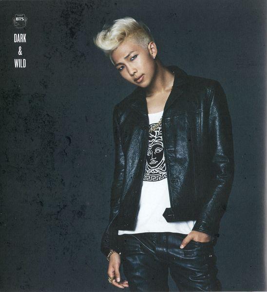 Tags: K-Pop, BTS, Rap Monster, Bracelet, Black Pants, Eyeliner, Gray Background, Hand In Pocket, Make Up, Ring, Text: Album Name, Leather Jacket