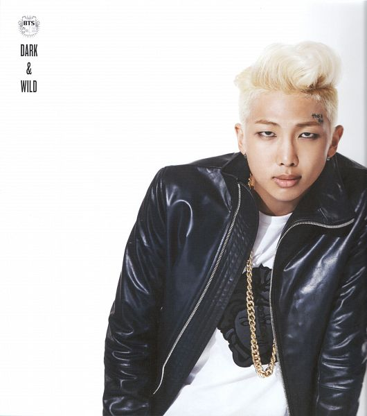 Tags: K-Pop, BTS, Rap Monster, Necklace, Tattoo, Text: Artist Name, Leather Jacket, Black Jacket, Black Outerwear, Make Up, Light Background, Text: Album Name