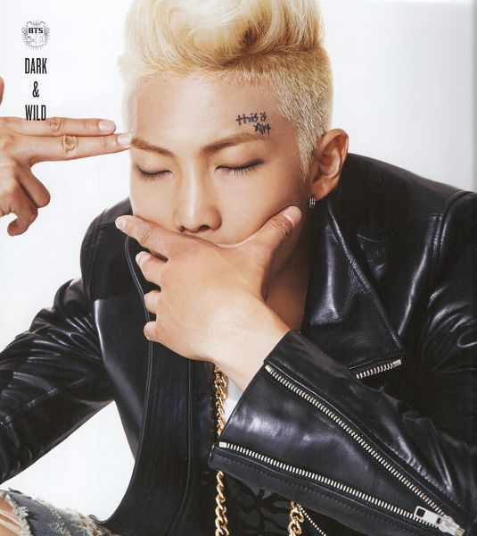 Tags: K-Pop, BTS, Rap Monster, White Background, Pointing, Black Outerwear, Eyes Closed, Covering Mouth, Black Jacket, Necklace, Tattoo, Light Background