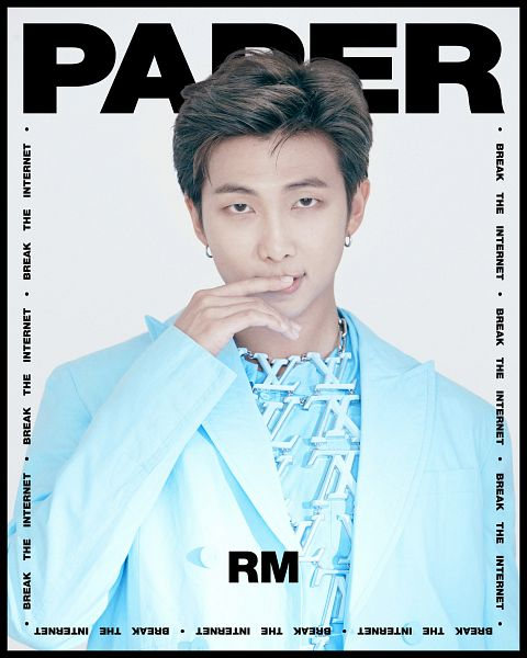 Tags: K-Pop, BTS, Rap Monster, Text: Artist Name, Blue Outfit, Light Background, Blue Outerwear, White Background, Text: Magazine Name, Close Up, Frame, English Text