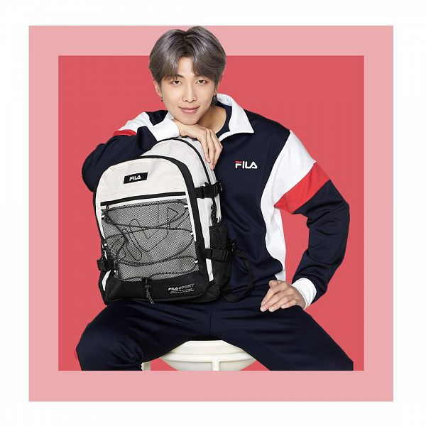 Tags: K-Pop, BTS, Rap Monster, Hand On Leg, Sitting On Chair, Backpack, Chair, Red Background, Holding Bag, Bag, Holding Object, White Border