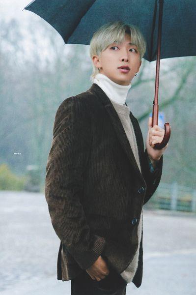 Tags: K-Pop, BTS, Rap Monster, Black Eyes, Sweater, Brown Outerwear, Umbrella, Looking Back, Turtleneck, Collar (Clothes), Scan, BTS 2020 Winter Package