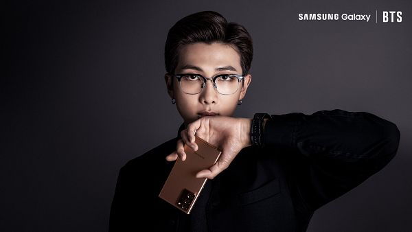Tags: K-Pop, BTS, Rap Monster, English Text, Watch, Text: Brand Name, Ring, Wristwatch, Smartphone, Glasses, Black Eyes, Holding Object