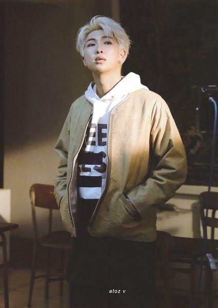Tags: K-Pop, BTS, Intro: Persona, Rap Monster, Hoodie, Black Pants, Hand In Pocket, Brown Outerwear, Serious, Hood, BTS Memories of 2019, Scan