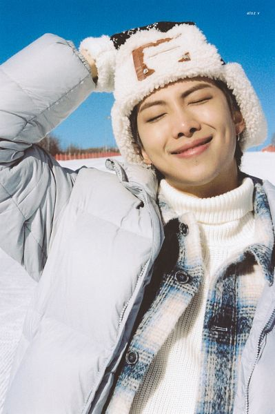 Tags: K-Pop, BTS, Rap Monster, Eyes Closed, Blue Outerwear, Sweater, Dimples, Snow, Outdoors, Gloves, Hand On Head, Fur