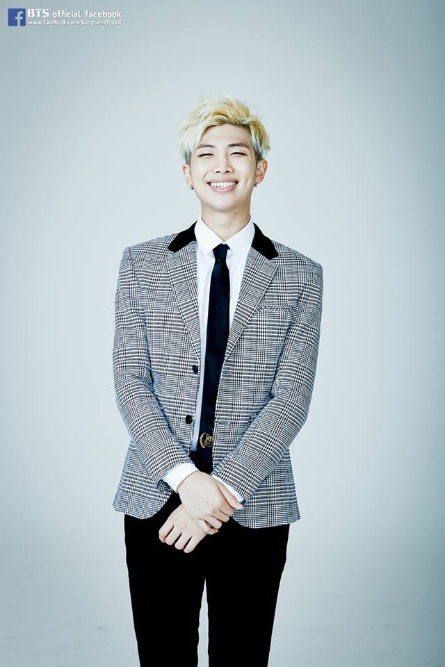 Tags: K-Pop, BTS, Rap Monster, Black Pants, Checkered, Gray Background, Grin, Checkered Jacket, Black Eyes, Tie, Gray Outerwear, Gray Jacket