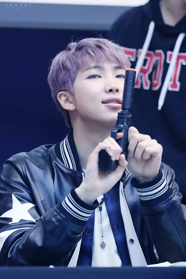Tags: K-Pop, Bangtan Boys, Rap Monster, Purple Hair, Gun, Black Jacket, Weapons, Holding Weapon, Necklace, Black Outerwear, Leather Jacket, Fansigning Event