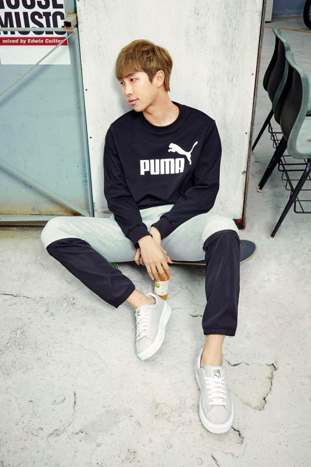Tags: K-Pop, BTS, Rap Monster, Black Shirt, Sitting On Ground, Full Body, Bottle, Leaning On Wall, Looking Away, Leaning Back, Puma