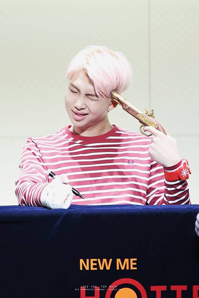 Tags: K-Pop, Bangtan Boys, Rap Monster, Gun, Striped Shirt, Holding Weapon, Pink Hair, Striped, Red Shirt, Eyes Closed, Suspenders, Table