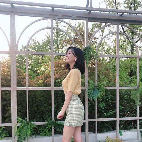 Tags: K-Pop, Lovelyz, Ryu Sujeong, Plant, Medium Hair, Bare Legs, Eyes Closed, White Skirt, Skirt, Checkered, Yellow Shirt, Outdoors