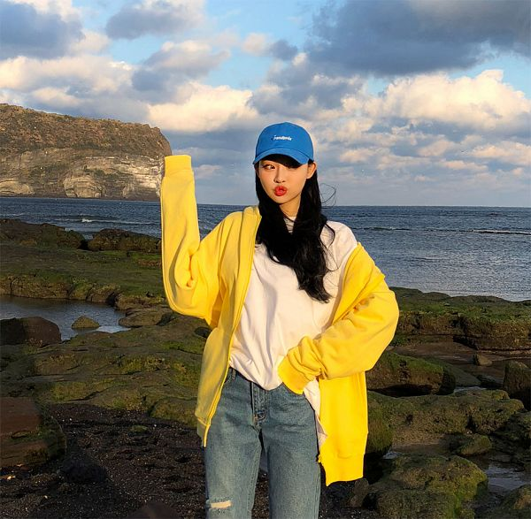 Tags: Fashion, Sae-eun, Hat, Pouting, Hood, Blue Headwear, Hoodie, Outdoors, Yellow Outerwear, Looking Away, Blue Pants, Jeans