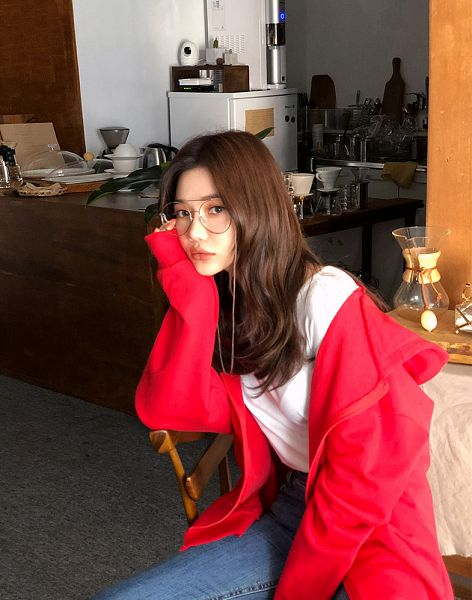 Tags: Fashion, Seo Sung-kyung, Red Jacket, Close Up, Blue Pants, Glasses, Chin In Hand, Sitting On Chair, Hood, Jeans, Red Outerwear, Hoodie