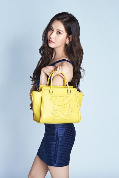 Tags: K-Pop, Girls' Generation, Seohyun, Bare Legs, Sleeveless Dress, Sleeveless, Blue Dress, Bag, Wavy Hair, Bare Shoulders, Blue Background, Android/iPhone Wallpaper