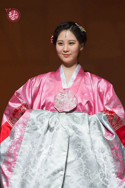 Tags: K-Pop, Girls' Generation, Seohyun, Pink Dress, Hair Ornament, Brown Background, Hair Up, Looking Away, Pink Outfit, Hanbok, Moon Embracing the Sun, Android/iPhone Wallpaper